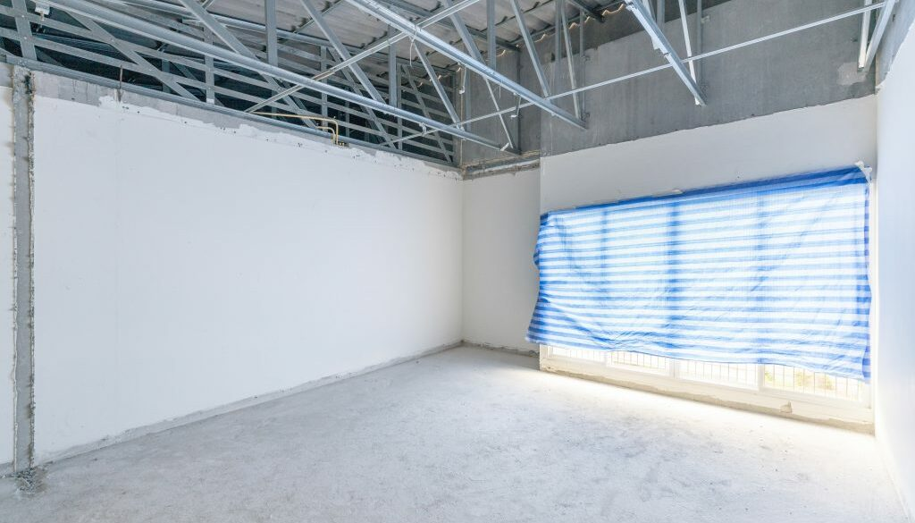 Construction site of empty Interior space, unfinished building a