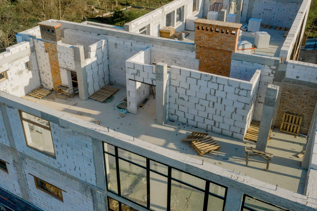 Building site of a house under construction made from white foam concrete blocks. Building new frame of home