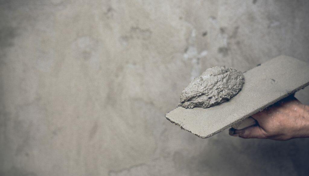 Plasterer renovating indoor walls.