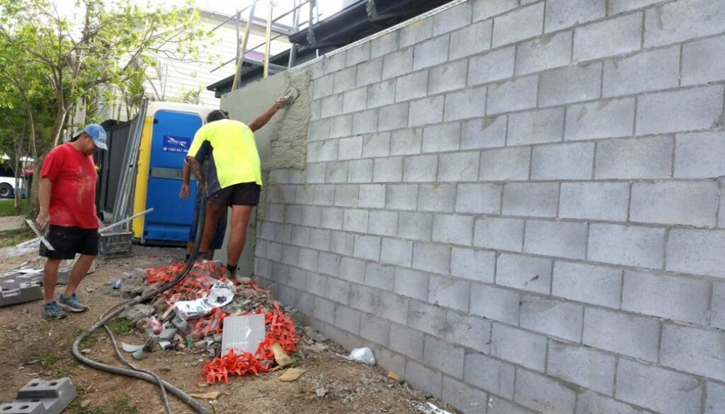 charlie-and-sons-teamwork-rendering-the-retaining-wall-1