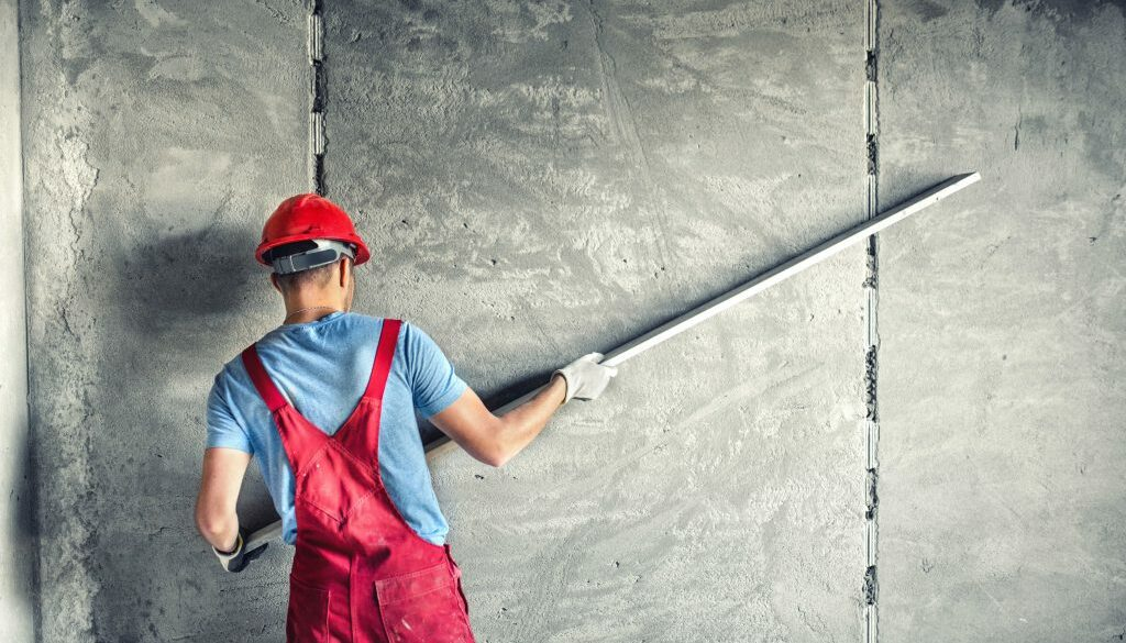 industrial-worker-with-plastering-tools-renovating-p3n7pts_optimized